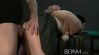 Bondage & discipline Hard-core Dark-hued haired victim has mounds trussed to the ceiling before bum hook