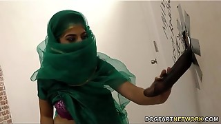 Nadia Ali having joy with ebony sausage in a gloryhole