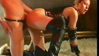 Leather dressed gal in hip high shoes gets strewn with jizz