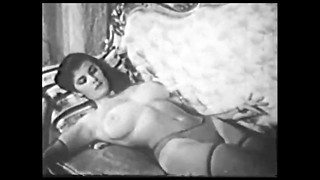 Eve Eden posing bare-breasted