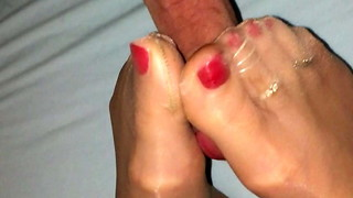 Taunting and footjob with her nylon soles