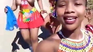 Big-boobed Zulu dolls dancing stripped to the waist selfie