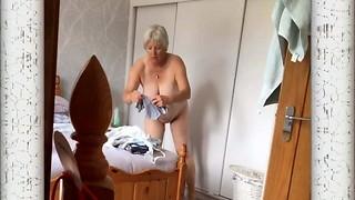 Mature  Female Caught switching on spycam