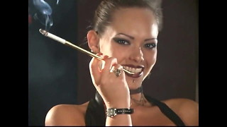 Fantastic Leather Domme smoking with holders
