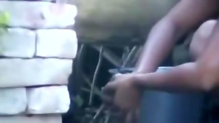wow... extraordinaire desi village girl bathing outside