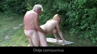 Insane grandfather gets satiated by ample bumpers light-haired breezy near a woods