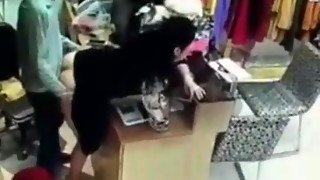 Chief has romp with worker behind cash register in China