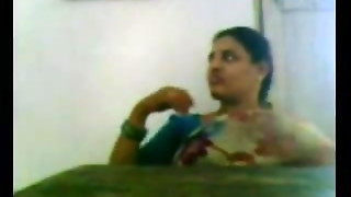 Desi Aunty in Saree Demonstrating Cupcakes
