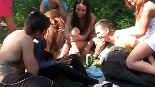 Schoolgirl lovemaking at outdoor soiree in a tent