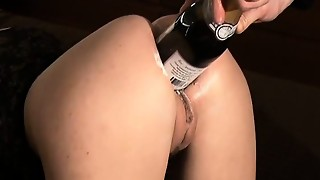 Outrageous first-timer nails a wine bottle in her bum