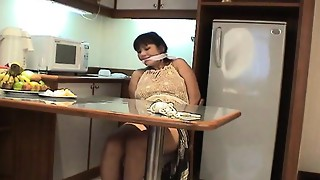 Mature dark haired with gigantic funbags strapped up and pawed up