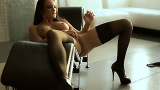 Suntanned toned Teal Conrad fumbles her huge bra-stuffers and