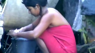 wow... epic desi village woman bathing outside