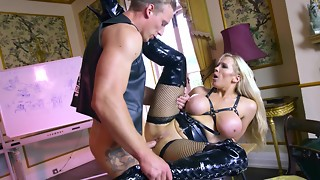 Blondie with massive faux globes is deep throating a large hard-on in leather
