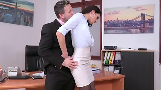 A honey is with her chief in the office and she is stretching her gams for him