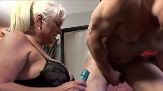 A gigantic blonde grandmother is getting penetrated by a youthful fellow on the bed